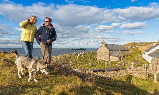 Wales   Couple walking dog on Coast Path